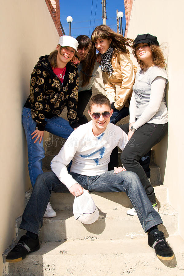Group of young people on the stairs stock images