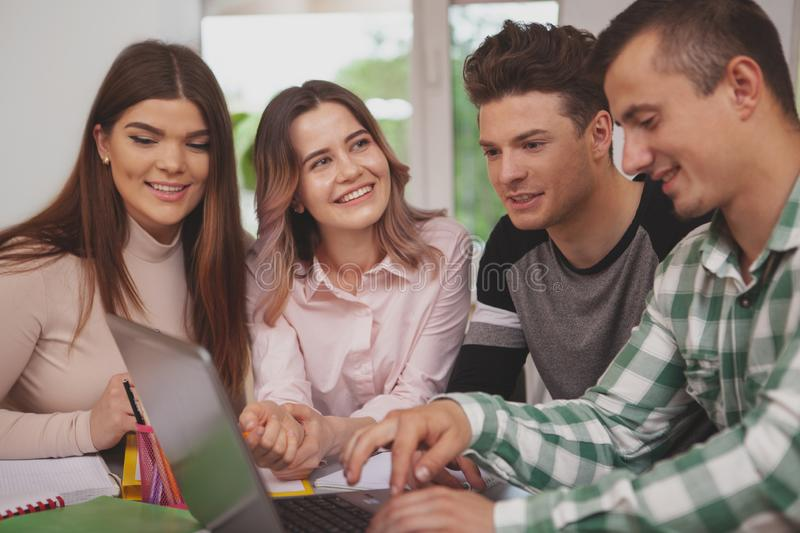 Group of young people studying together at college classroom royalty free stock photography