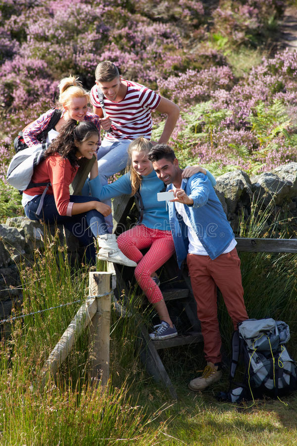 Group Of Young People Taking Photograph On Hike stock image