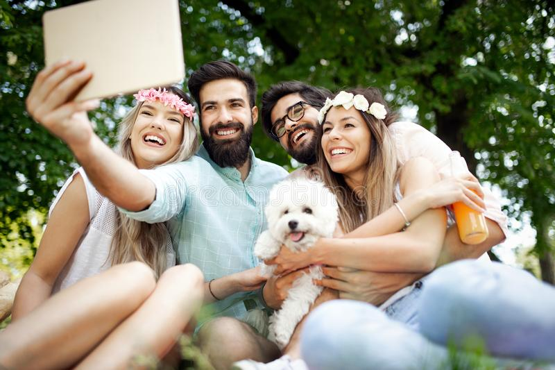 Group of young people taking a selfie outdoors, having fun royalty free stock images