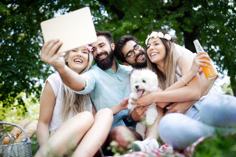 Group of young people taking a selfie outdoors, having fun stock photo