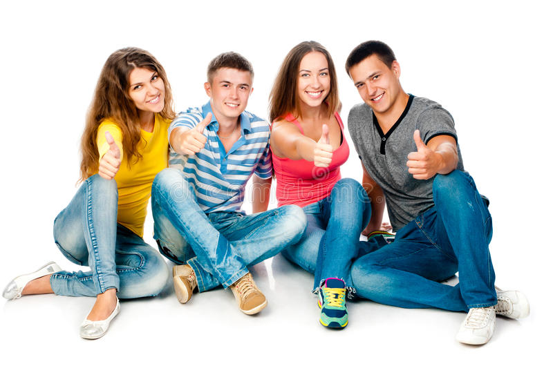 Group of young people with thumbs up stock photos