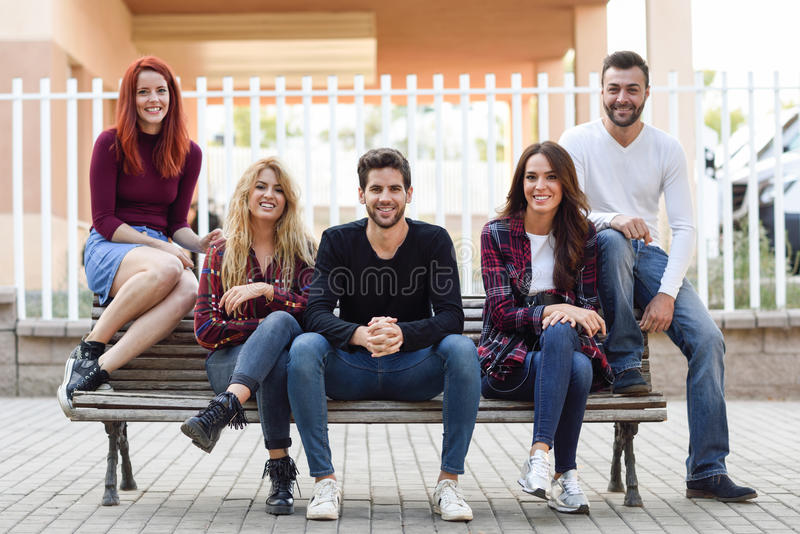 Group of young people together outdoors in urban background royalty free stock image