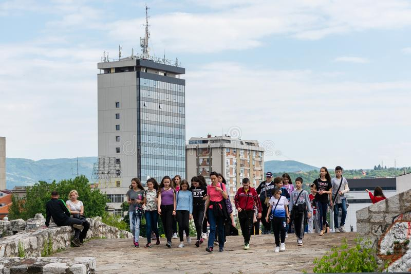 Group of young people with travel guide woman on a sightseeing tour visiting old medieval fortress in the city of Nis, Serbia, Eur. Nis, Serbia - May 25, 2019 stock images