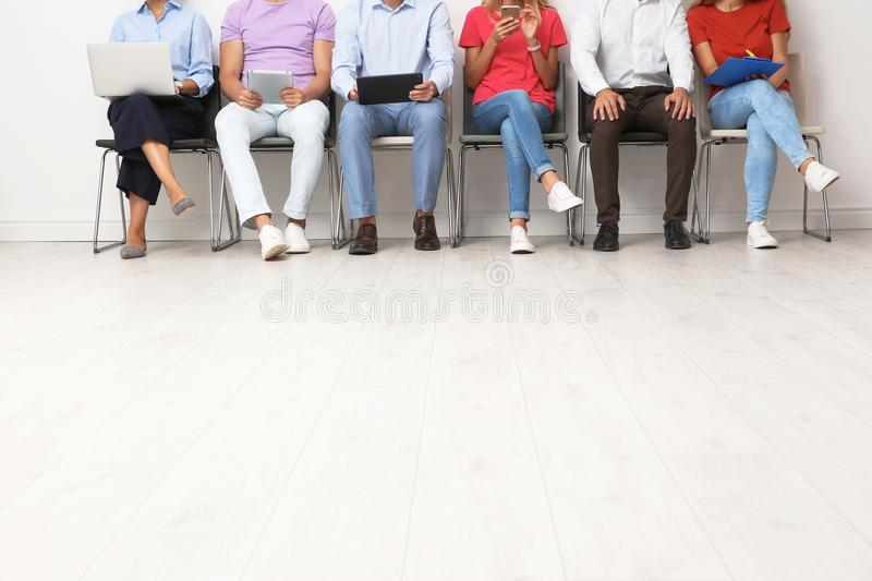 Group of young people waiting for job interview royalty free stock photo
