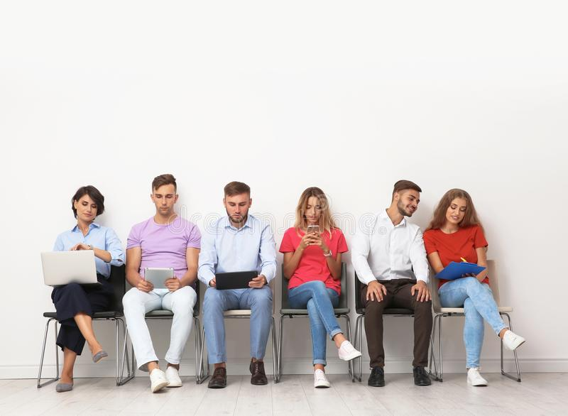 Group of young people waiting for job interview stock images