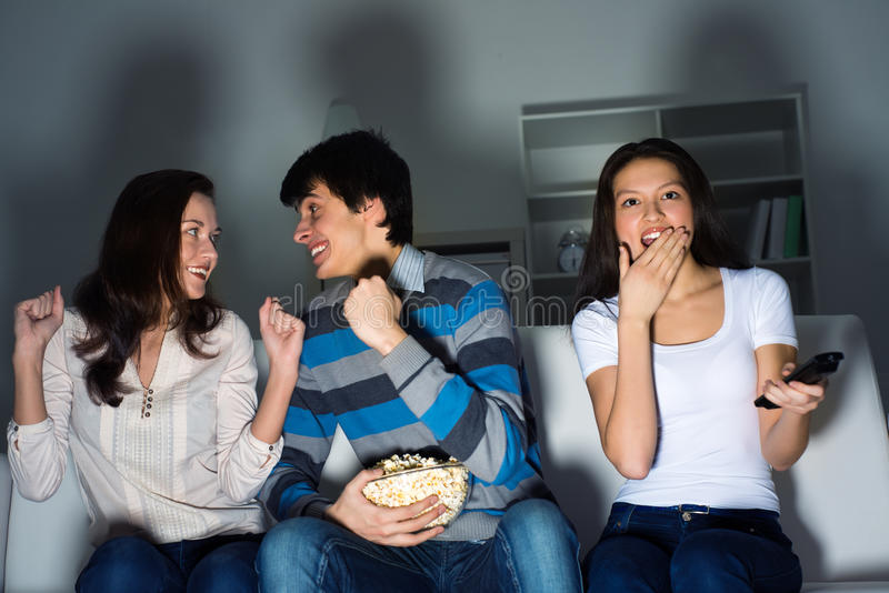 Download Group Of Young People Watching TV On The Couch Stock Image - Image: 30739725