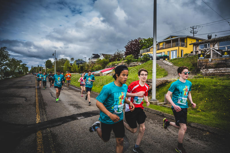 Group of Young Runners and Kids Racing Together. CARLETON, CANADA - June 4, 2017. During the 5th Marathon of Carleton in Quebec, Canada. Group of Young Runners royalty free stock images