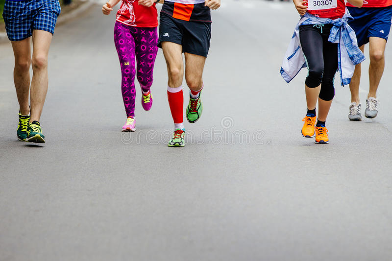 Group of young runners running city street. Ekaterinburg, Russia - May 21, 2017: group of young runners running city street in City half marathon royalty free stock image