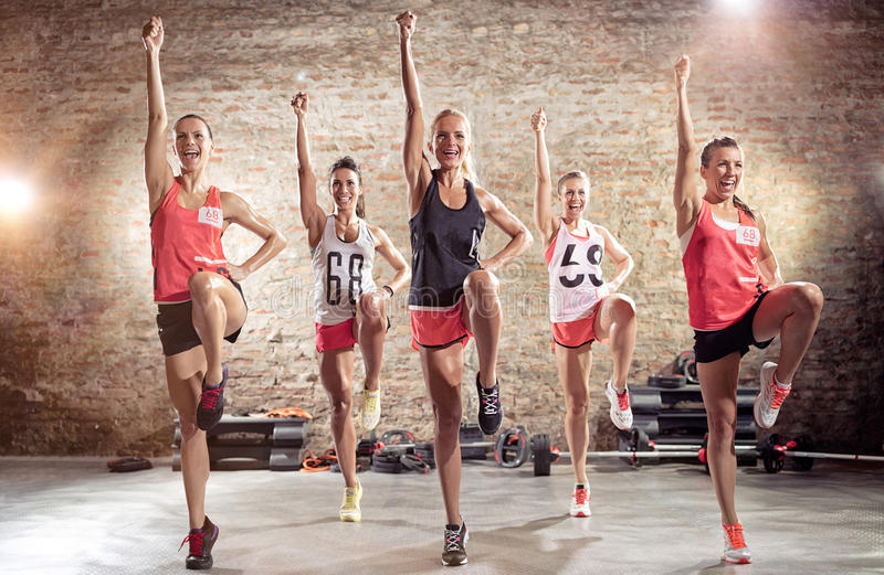 Group of young sporty people training together stock photos