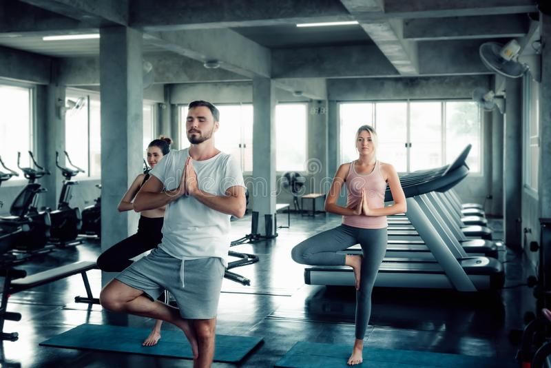 Group of Sporty Yogi are Practicing Yoga With Trainer in Fitness Gym., Athlete Healthy People in Sportswear are Working Out Traini stock photography