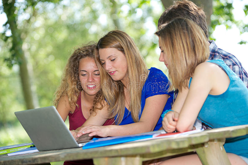 Group of young student using laptop outdoor stock photo