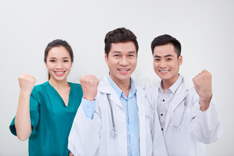Group of young and successful doctors over the abstract background.  royalty free stock photography