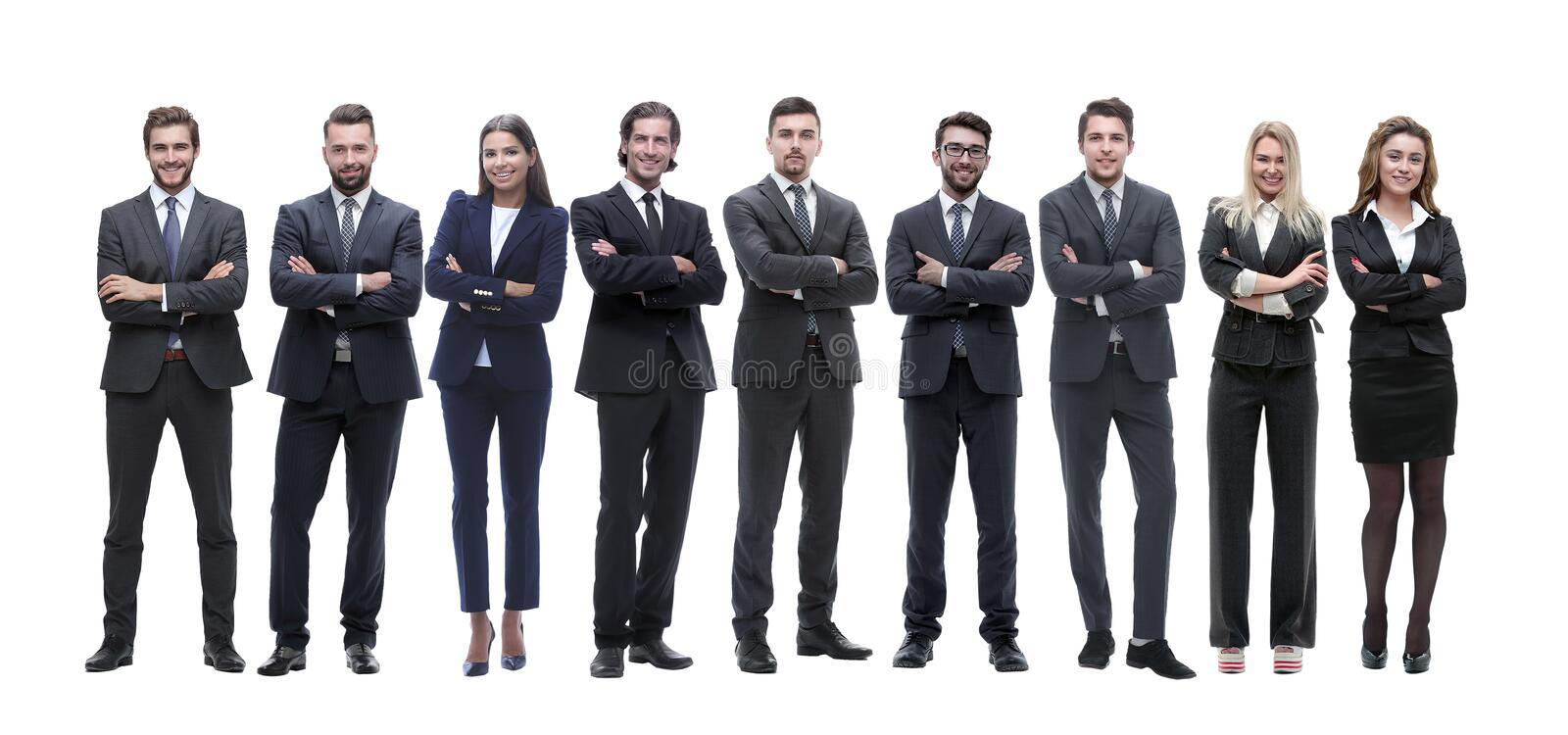 Group of young successful entrepreneurs standing in a row stock photo