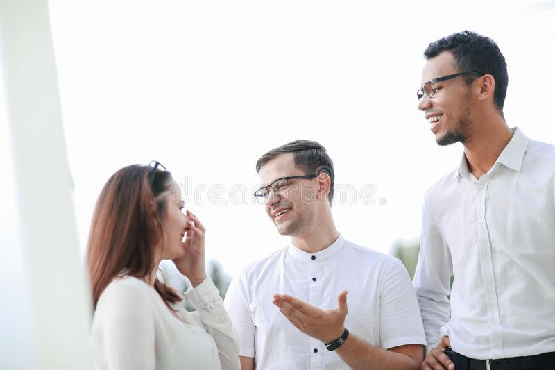 Group of young successful people standing together. royalty free stock images
