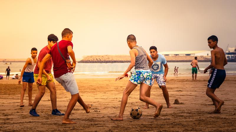 Group of young teenage boys playing soccer royalty free stock photo