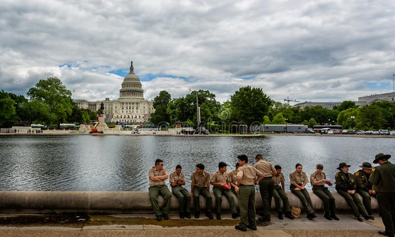 Group of young uniformed police display team officers sat in front of the Capitol Building in Washington DC, USA royalty free stock photos