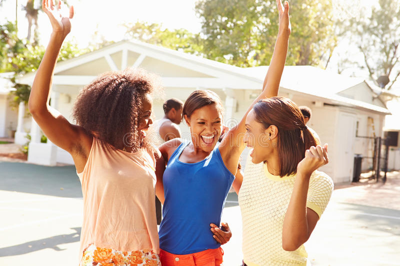 Group Of Young Women Cheering At Basketball Match stock photos