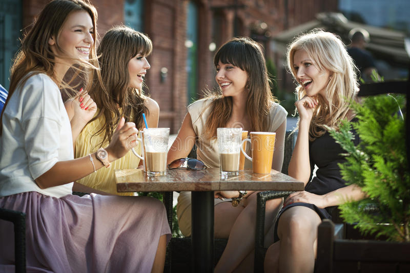 Group of young women drinking coffee royalty free stock photography