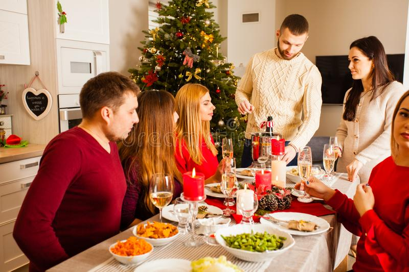Group of people celebrating New year around table stock photography