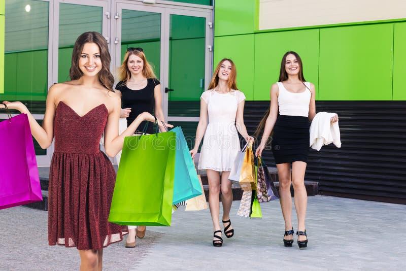 Group of young women shopping. stock photos