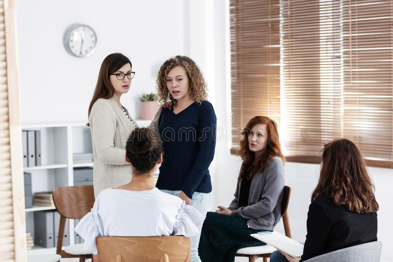 Group of young women talking sitting in a circle. Psychological support concept royalty free stock photos