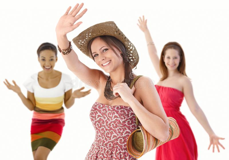 Group of young women waving hands in summer dress. Group of happy young women waving hands in summer dresses stock images