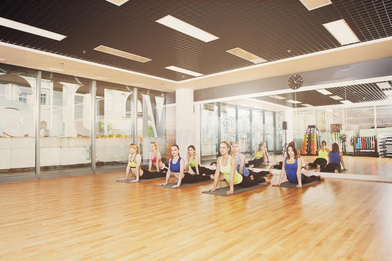 Group of young women in yoga class royalty free stock images