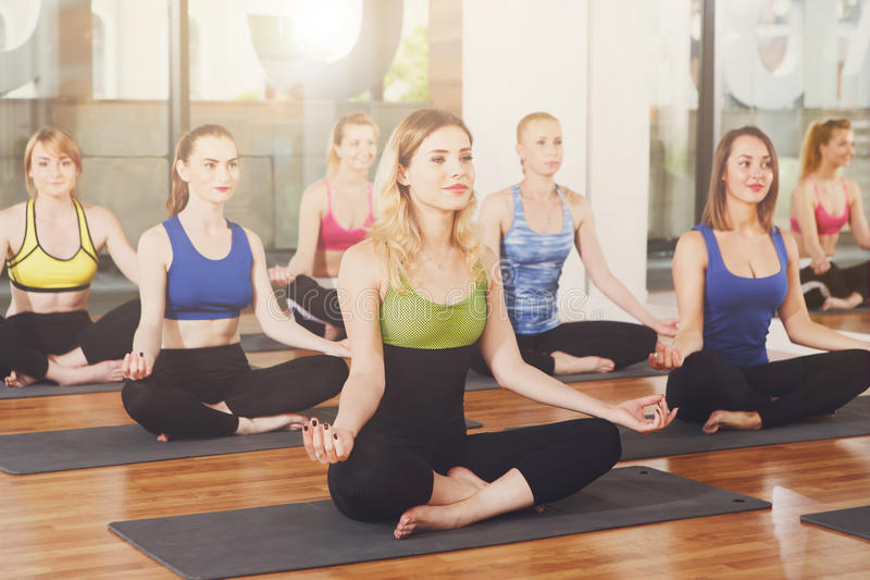Group of young women in yoga class stock photos