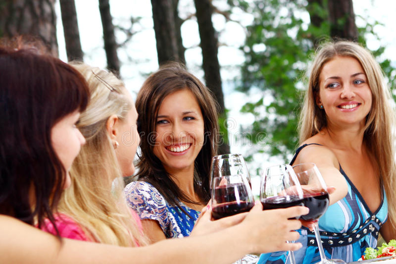 Group of young womens drinking wine stock photo