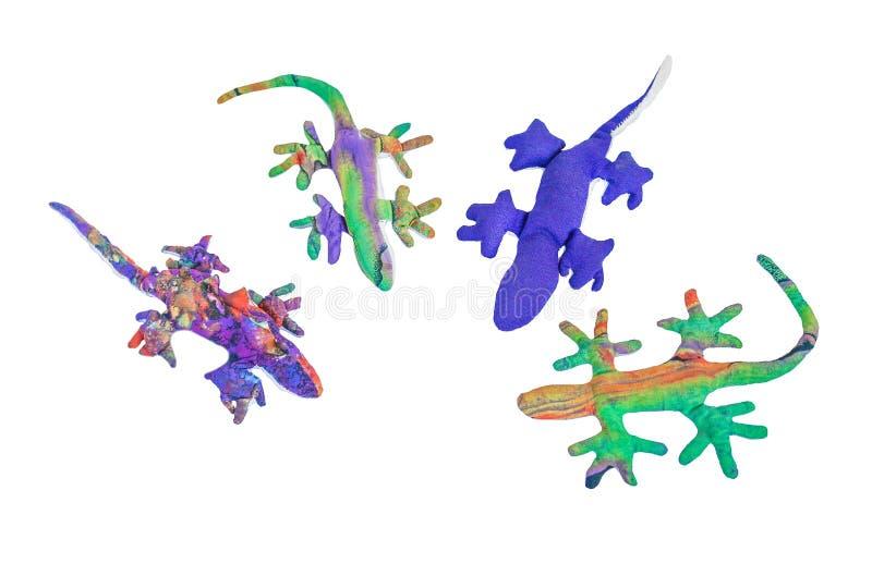 Groupe coloré de jouet de gecko de tissu de vue supérieure d'isolement sur le fond blanc image libre de droits