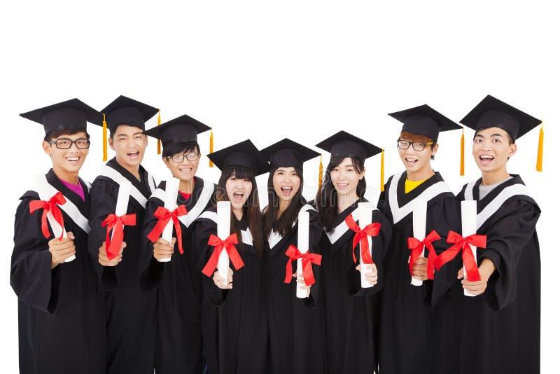 Groupe d'étudiants célébrant l'obtention du diplôme images stock