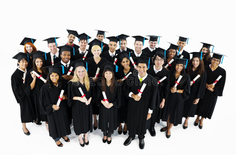 Groupe d'étudiants gradués du monde photo stock