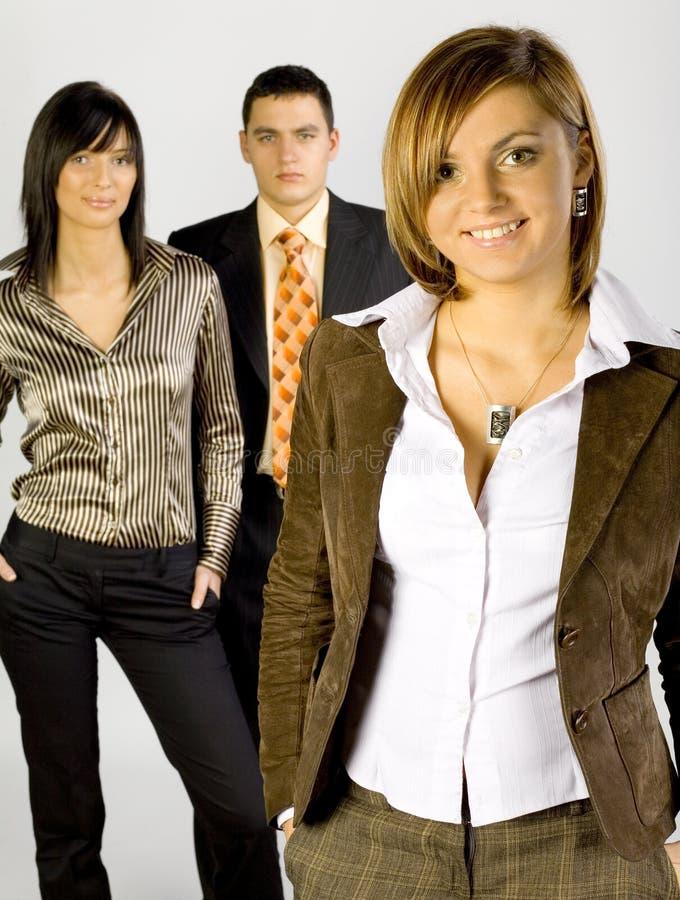 Groupe d'affaires avec l'amorce féminine photo libre de droits