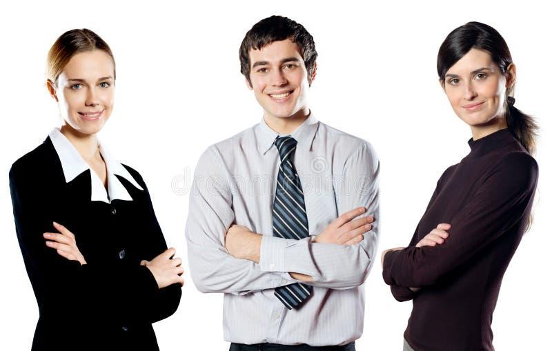 Groupe d'isolement de jeune équipe de sourire heureuse d'affaires photos stock