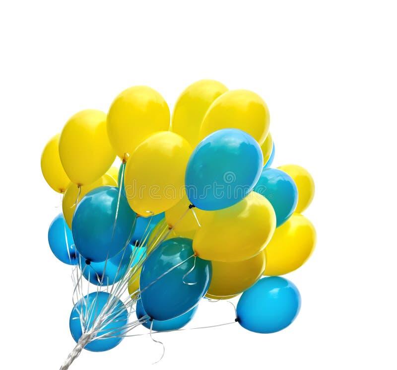 Groupe de ballons bleus et jaunes image stock
