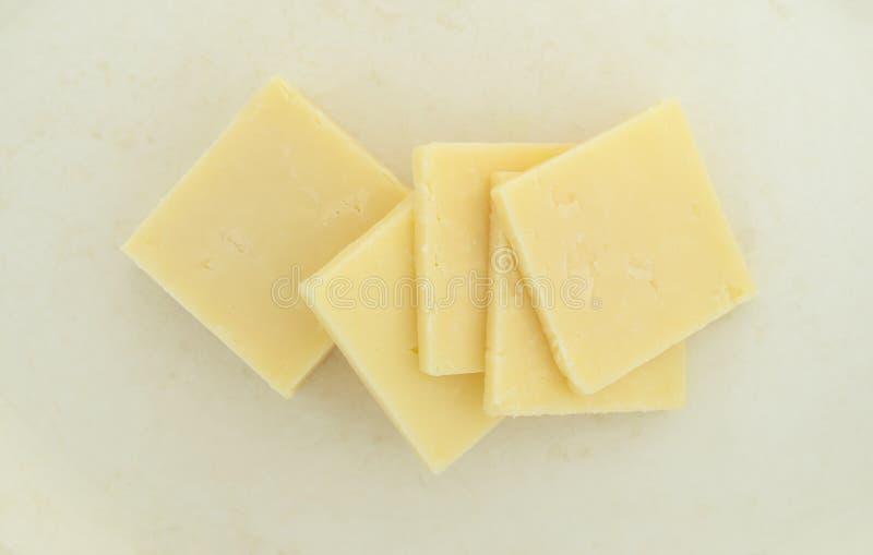 Groupe de fromage de cheddar pointu photos libres de droits