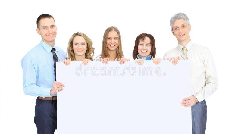Groupe de gens d'affaires jugeant une annonce de bannière d'isolement sur le blanc photos stock