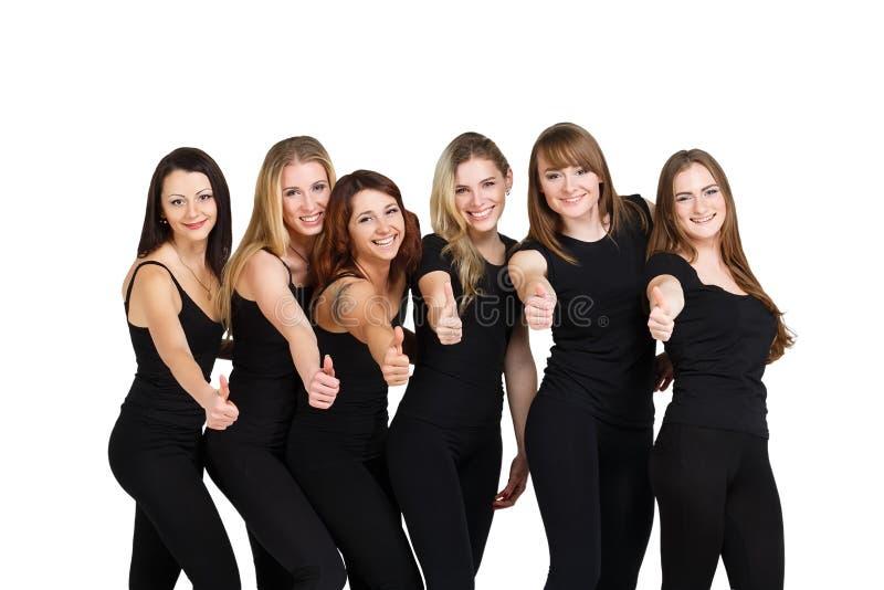 Groupe de jeunes femmes au blanc images stock