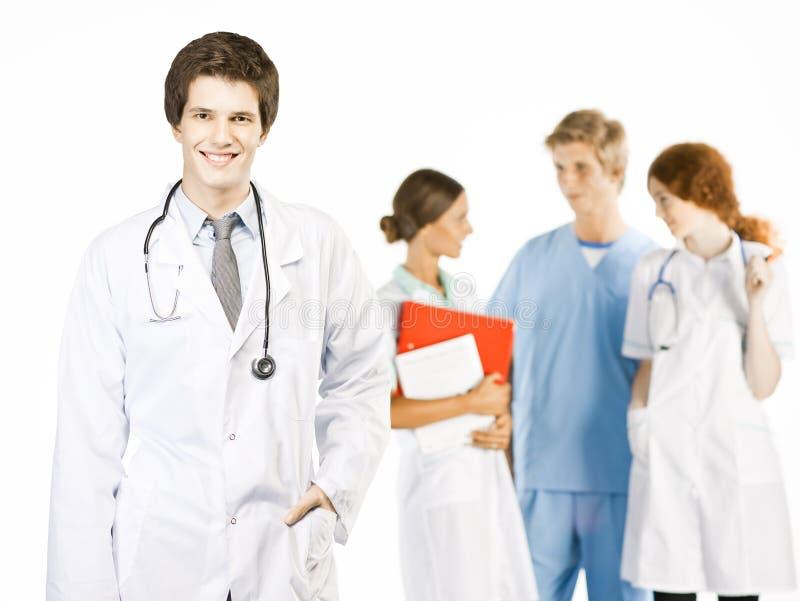 Groupe de médecins de sourire sur le fond blanc photo stock