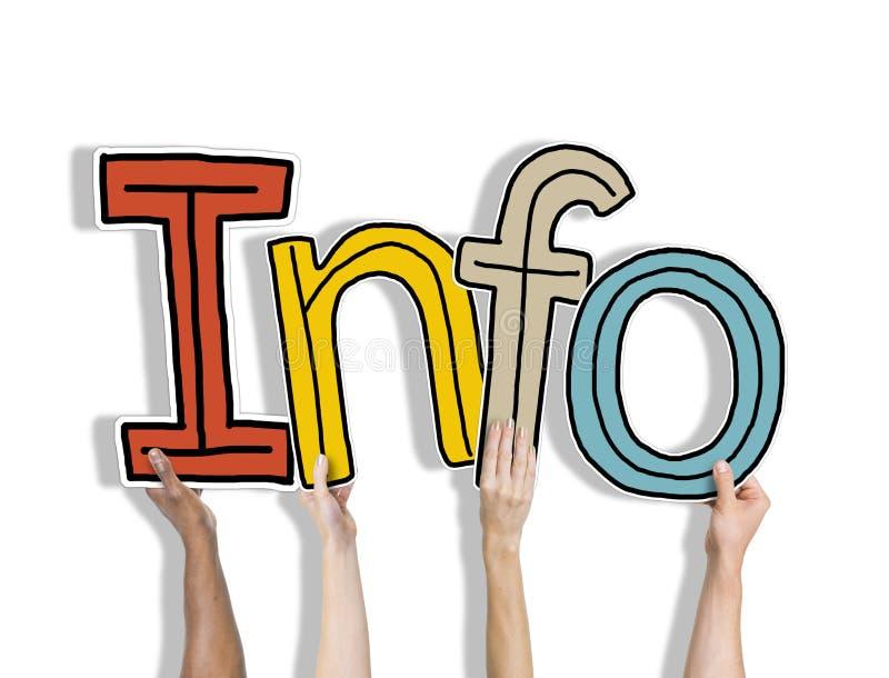 Groupe de mains tenant des infos de Word photos libres de droits