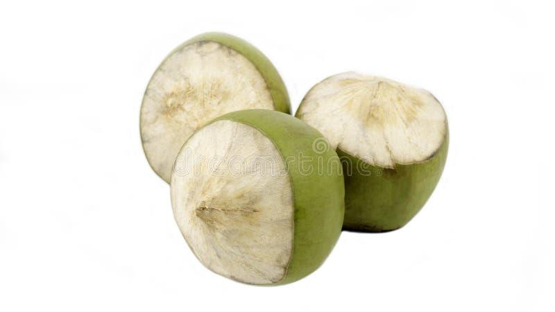 Groupe de noix de coco verte d'isolement photos stock