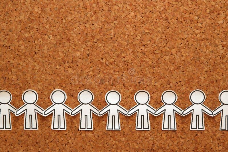 Groupe de personnes tenant des mains sur des babillards Concept de travail d'équipe image stock