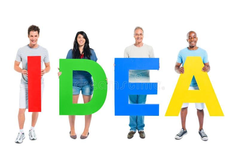 Download Groupe De Personnes Tenant L'idée De Word Image stock - Image du équipe, créativité: 45366521