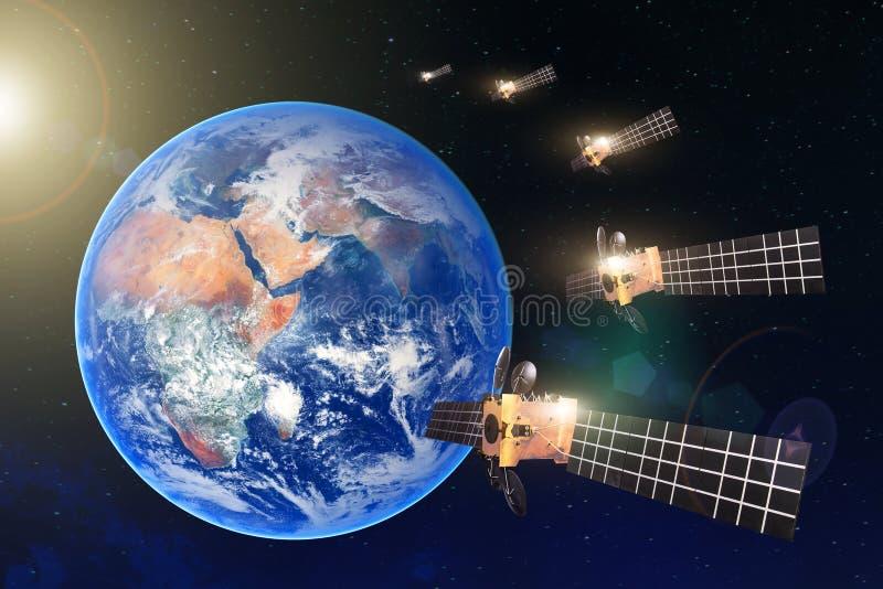 Groupe de satellites dans une rang?e dans l'orbite g?ostationnaire de la terre, pour la communication et les syst?mes de contr?le illustration libre de droits