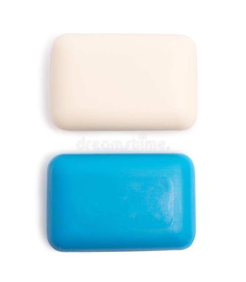 Groupe de savon de toilette bleu et blanc d'hygiène d'isolement sur le fond blanc photographie stock libre de droits
