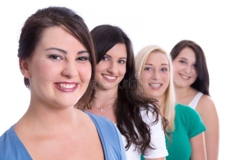 Groupe de stagiaires heureux dans les premiers emplois d'isolement sur le backgrou blanc photographie stock