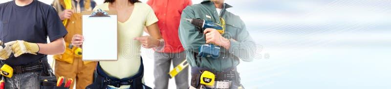 Groupe de travailleurs de la construction image stock