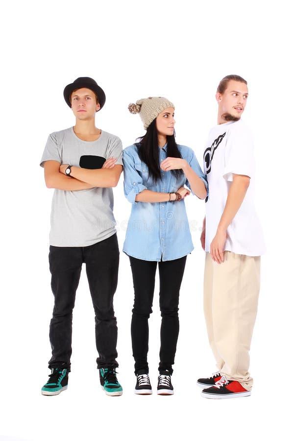 Groupe de trois amis sur le blanc image stock