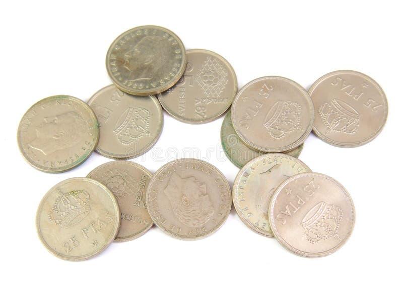 Groupe de vieilles pièces de monnaie espagnoles d'isolement sur un blanc photo stock